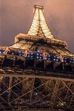 Preview iPhone wallpaper Eiffel Tower bottom view, night, illumination