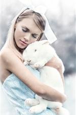 Girl and white rabbit, winter, snow