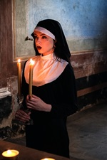 Girl, nun, prayer, candles
