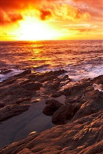 Preview iPhone wallpaper Sunset sea, coast, rocks, red sky, clouds
