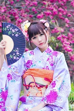 Beautiful Japanese girl in the garden, kimono, flowers, spring
