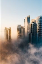 Preview iPhone wallpaper Dubai city in morning, fog, skyscrapers, UAE