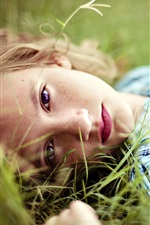 Preview iPhone wallpaper Girl lying on grass, blonde, face