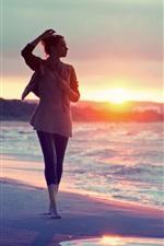 Girl walking at the beach, sea, sunset