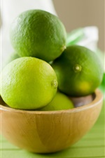 Preview iPhone wallpaper Green lemon, lime, bowl