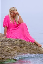Preview iPhone wallpaper Blonde girl, pink dress, sit at lakeside