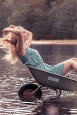 Preview iPhone wallpaper Blonde girl sit in small cart, water, lake