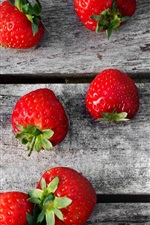 Preview iPhone wallpaper Delicious strawberries, wooden board