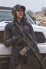 Preview iPhone wallpaper Girl use assault rifle, car, light