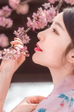 Preview iPhone wallpaper Japanese girl, sakura, pink flowers, spring