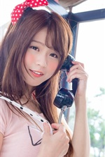 Preview iPhone wallpaper Lovely Asian girl use telephone