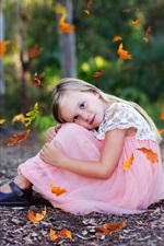 Preview iPhone wallpaper Lovely little girl sit on ground, autumn, leaves