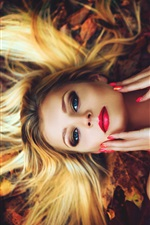 Preview iPhone wallpaper Makeup girl, hairstyle, blonde, lying on ground, autumn