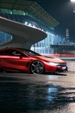 Red BMW car at night city road