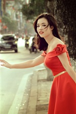 Preview iPhone wallpaper Red skirt Asian girl at street