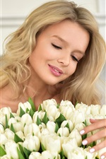 Preview iPhone wallpaper Smile blonde girl, white tulips