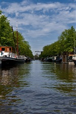 Amsterdam city views, river, boats, trees, clouds