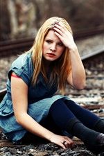Preview iPhone wallpaper Blonde girl sit at railroad