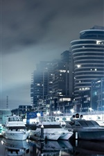 City night, houses, lights, boats, dock