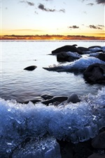 Preview iPhone wallpaper Coast, stones, ice, sea, sunset