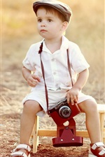 Preview iPhone wallpaper Cute little boy use camera