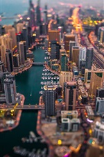 Preview iPhone wallpaper Dubai, skyscrapers, boats, road, dusk, blurry