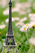 Preview iPhone wallpaper Eiffel Tower model in the flowers