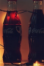Preview iPhone wallpaper Four bottles Coca Cola, drinks