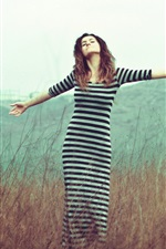 Preview iPhone wallpaper Freedom girl, black and white striped skirt, grass