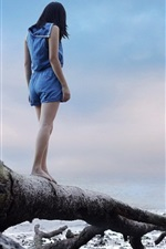 Preview iPhone wallpaper Girl standing on dry tree