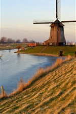 Preview iPhone wallpaper Holland, windmill, frozen river, grass