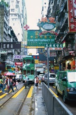 Preview iPhone wallpaper Hong Kong, city street, road, cars, people, shops