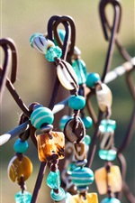 Preview iPhone wallpaper Jewelry on fence