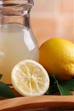 Preview iPhone wallpaper Lemon, fruit juice, bottle, spoon, leaves