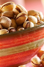 Preview iPhone wallpaper One bowl pistachios, nuts