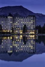 Preview iPhone wallpaper Banff National Park, hotel, lake, water reflection, mountains, lights, night, Canada