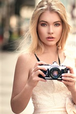 Preview iPhone wallpaper Blonde girl use Olympus camera