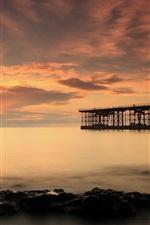 Preview iPhone wallpaper Bridge, pier, sea, stones, dusk