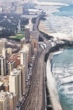 Chicago city at winter, skyscrapers, snow, sea, coast, roads