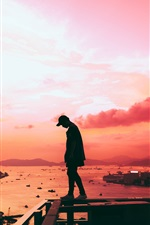 Preview iPhone wallpaper City, sunset, sea, man, fence