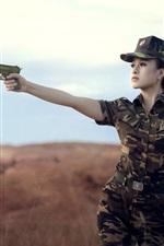 Preview iPhone wallpaper Female soldier, Asian girl, use gun, camouflage