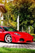Preview iPhone wallpaper Ferrari red supercar side view, trees, sunshine