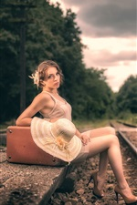 Preview iPhone wallpaper Girl sit at railway side, suitcase, retro style