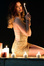 Preview iPhone wallpaper Girl sit, candles, flame, black background