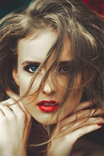Hair messy girl, red lips, hands, blue eyes
