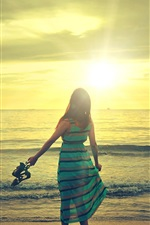 Preview iPhone wallpaper Happy girl walk in beach, sunshine, sea, waves