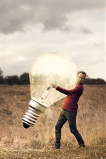 Preview iPhone wallpaper Man and huge lamp, grass, creative picture