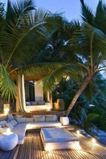 Preview iPhone wallpaper Palm trees, evening, hut, sofa, lights, sea