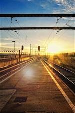Railway station, track, sunset, glare