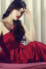 Preview iPhone wallpaper Red dress Asian girl, sofa